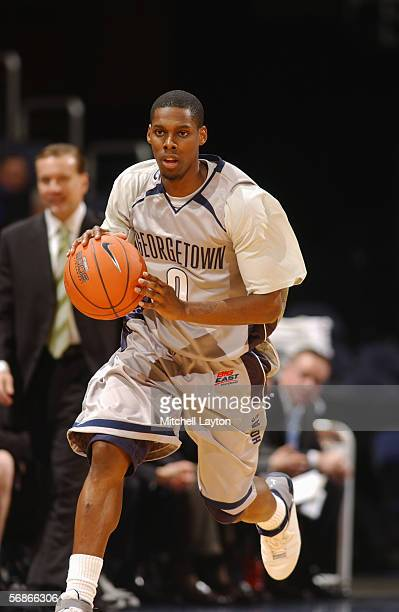 Ashanti Cook of Georgetown Hoyas dribbles the ball up court against the Providence Friars on January 5 2006 at MCI Center in Washington DC Georgetown...