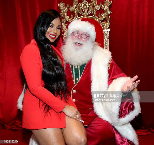 """Ashanti Douglas poses with Santa during """"It's a Wonderful Lifetime"""" first holiday party of the year at STK Los Angeles on October 22, 2019 in Los..."""
