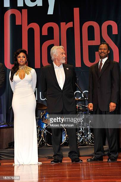Ashanti Kenny Rogers and Dr John Silvanus Wilson Jr attend the Ray Charles Forever Stamp launch at Morehouse College Ray Charles Performing Arts...
