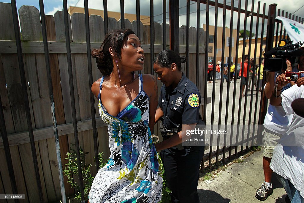Ashaundre Young is arrested after becoming vocal and disruptive during a protest againt the evictions being carried out at the apartment complex in which she lives on June 15, 2010 in Miami, Florida. A small protest organized by Take Back the Land tried to prevent the eviction but it was unsuccessful. According to the activists, the bank, which now owns the apartment complex, is forcing the current residents out and they have no other homes to move to.