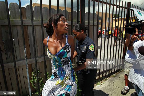 Ashaundre Young is arrested after becoming vocal and disruptive during a protest againt the evictions being carried out at the apartment complex in...