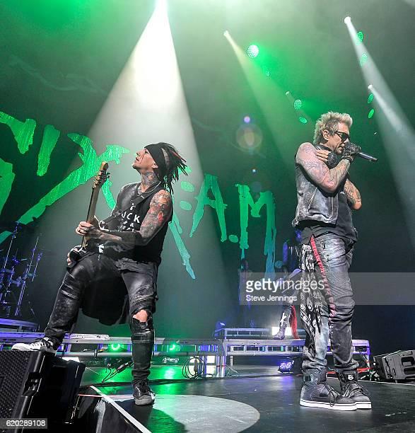 DJ Ashba and James Michael of Sixx AM perform on Halloween night at SAP Center on October 31 2016 in San Jose California