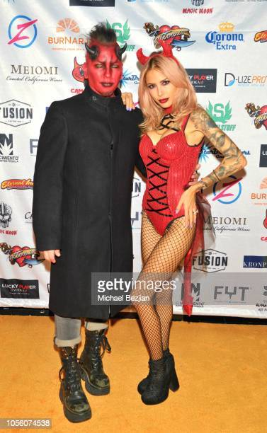 Ashba and Nathalia Ashba attend Tat2ween Opening Party on October 31 2018 in Las Vegas Nevada