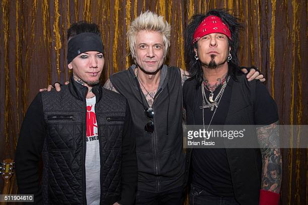 DJ Ashba James Michael and Nikki Sixx of SixxAM at Sanctum Soho on February 23 2016 in London England