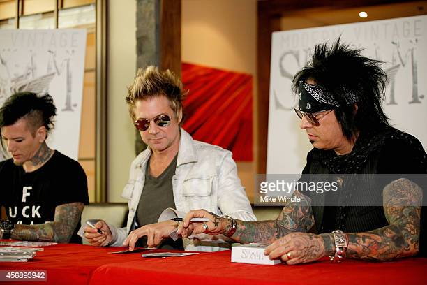 DJ Ashba James Michael and Nikki Sixx of SIXXAM sign copies of their new album 'Modern Vintage' at firstever instore appearance at Best Buy on...