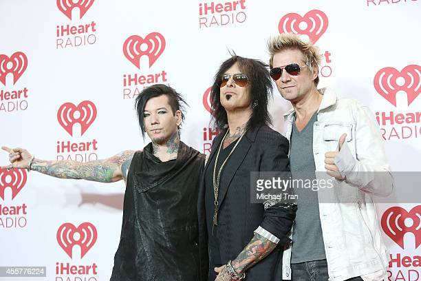 DJ Ashba Nikki Sixx and James Michael of SixxAM attend the iHeart Radio Music Festival press room held at MGM Grand Resort and Casino on September 19...