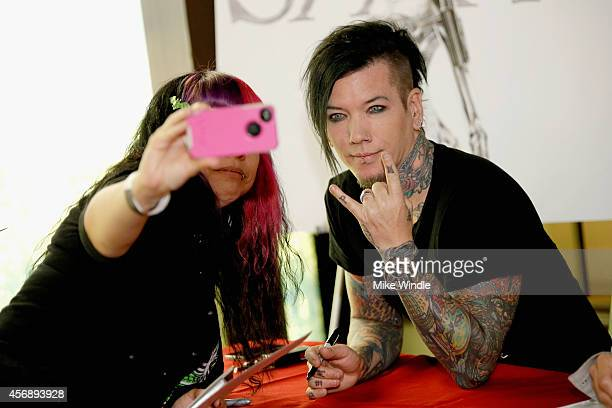 AM signs copies of their new album 'Modern Vintage' at firstever instore appearance at Best Buy on October 8 2014 in Burbank California