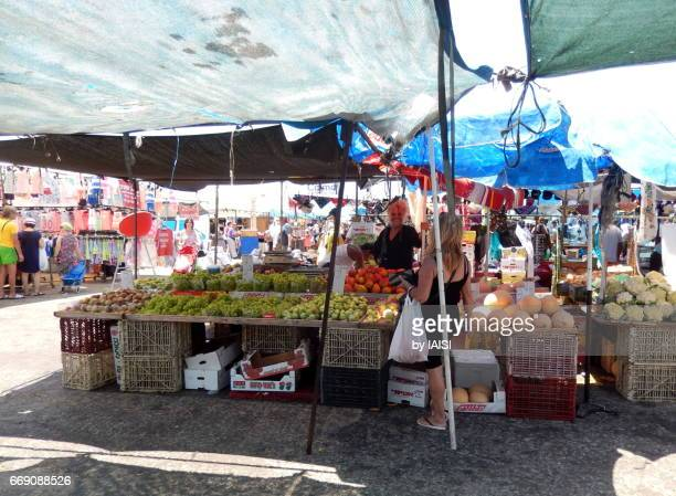 Ashdod market scene, a smiling vendor at the market by a hot summer day
