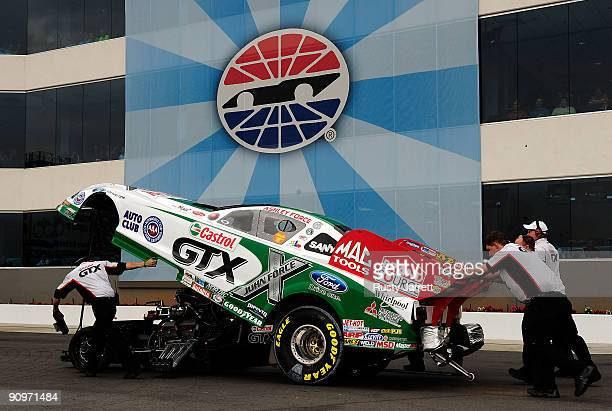 Ashely Force Hood driver of the Castrol GTX Ford is pushed to the staging area during third round qualifying for the NHRA Carolinas Nationals on...