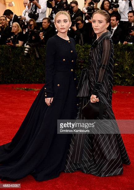 Ashely Olsen and MaryKate Olsen attend the Charles James Beyond Fashion Costume Institute Gala at the Metropolitan Museum of Art on May 5 2014 in New...