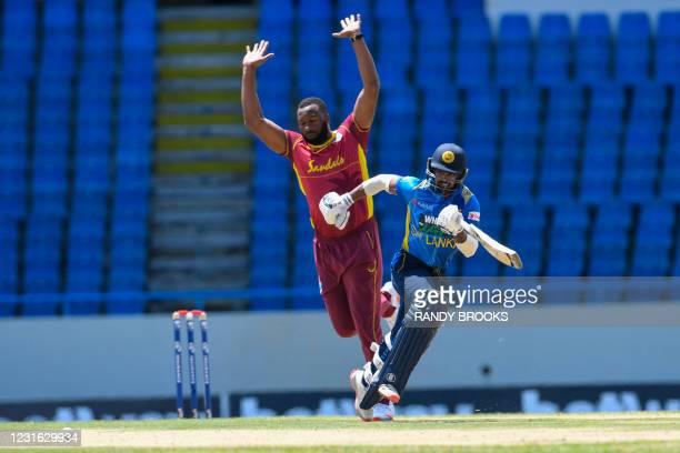 Ashen Bandara of Sri Lanka runs and Kieron Pollard of West Indies takes evasive action during the 1st ODI match between West Indies and Sri Lanka at...