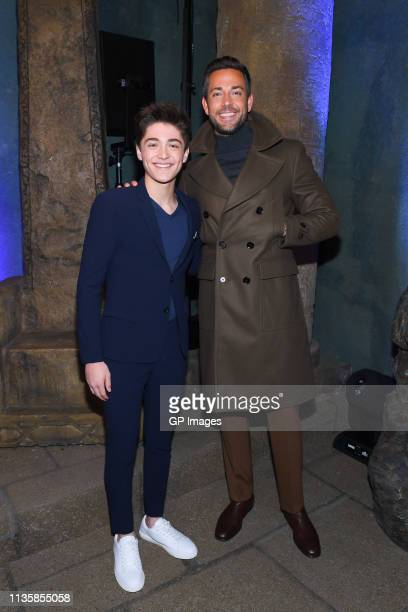 Asher Angel and Zachary Levi attend the unveiling of the Shazam World Exclusive Fan Experience on March 14 2019 in Toronto Canada