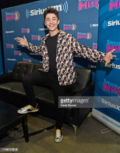 Asher Angel attends the SiriusXM Hits 1 broadcast backstage at the Billboards Music Awards at MGM Grand Garden Arena on April 30 2019 in Las Vegas...
