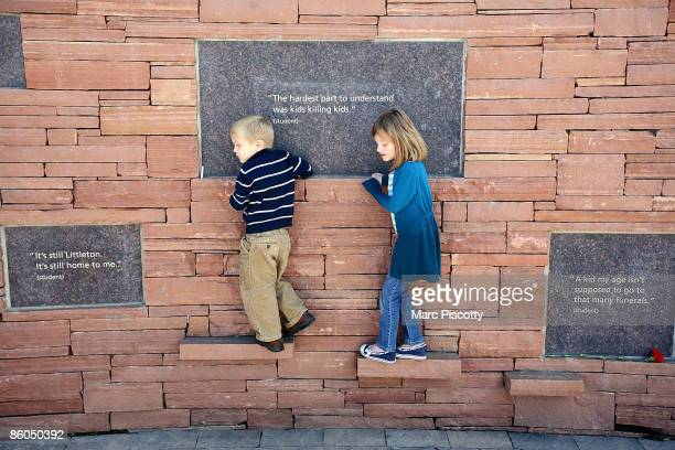 Asher Lankow and Lexi Lankow of Denver walk along the outside edge of the Columbine Memorial on the tenyear anniversary of the Columbine High School...