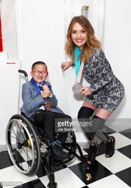 Asher Loera and Amy Purdy attend The 6th Annual 'Gold Meets Golden' Brunch hosted by Nicole Kidman and Nadia Comaneci and presented by CocaCola at...