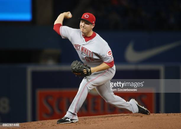 Asher Wojciechowski of the Cincinnati Reds delivers a pitch in the first inning during MLB game action against the Toronto Blue Jays at Rogers Centre...