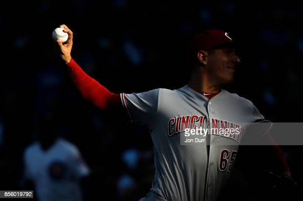 Asher Wojciechowski of the Cincinnati Reds pitches against the Chicago Cubs during the fifth inning at Wrigley Field on September 30, 2017 in...