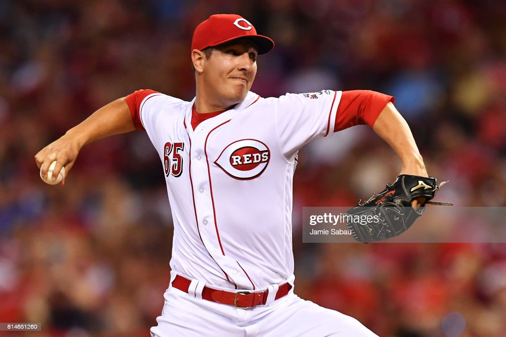 Asher Wojciechowski #65 of the Cincinnati Reds pitches in the seventh inning against the Washington Nationals at Great American Ball Park on July 14, 2017 in Cincinnati, Ohio. Washington shut out Cincinnati 5-0.