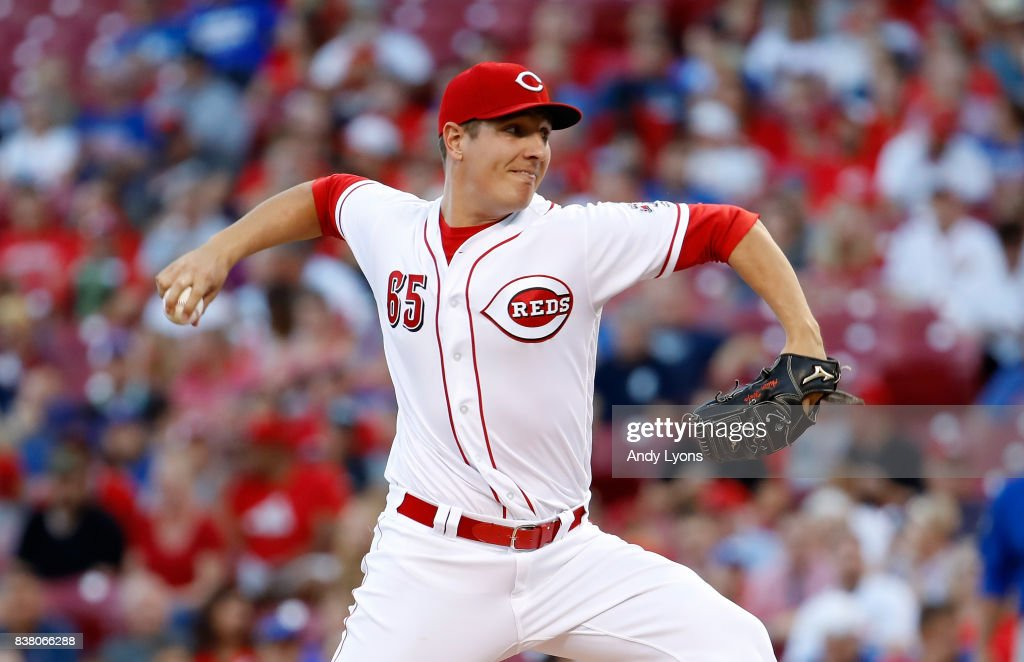 Asher Wojciechowski #65 of the Cincinnati Reds throws a pitch against the Chicago Cubs at Great American Ball Park on August 23, 2017 in Cincinnati, Ohio.