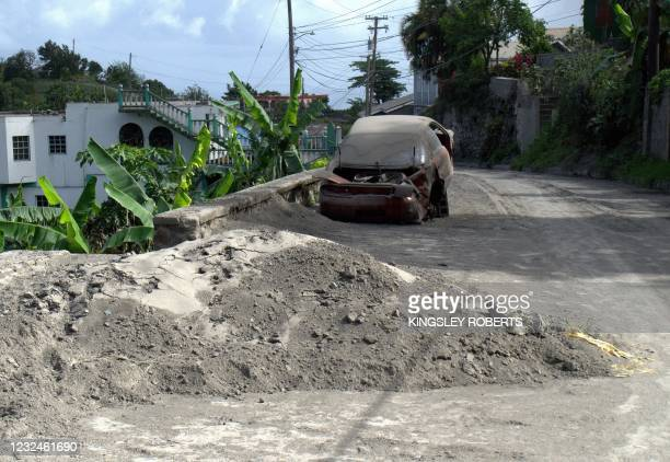 Ashes from La Soufriere volcano are seen on the side of the road at Rose Hall in Saint Vincent and the Grenadines on April 21, 2021. - The United...