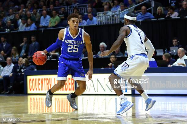 Asheville Bulldogs guard MaCio Teague defended by Rhode Island Rams guard Jarvis Garrett during a college basketball game between UNC Asheville...