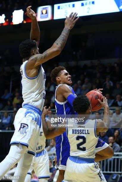 Asheville Bulldogs guard MaCio Teague defended by Rhode Island Rams forward Ryan Preston and Rhode Island Rams guard Fatts Russell during a college...