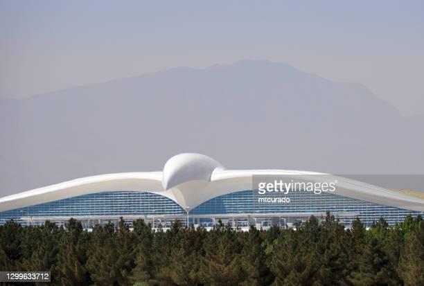 ashgabat international airport main terminal and forest, turkmenistan - ashgabat stock pictures, royalty-free photos & images