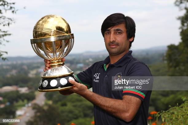 Ashgar Stanikzai the captain of the Afghanistan cricket team poses with The ICC Cricket World Cup Qualifier trophy the day after beating The West...