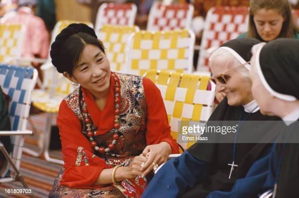 Ashi Kesang Choden Wangchuck mother of the King of Bhutan with two elderly nuns in Thimphu Bhutan not long after her son's coronation July 1974 She...