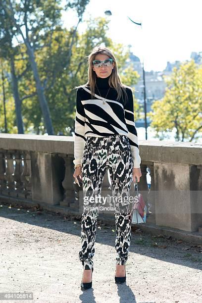 Ashion Blogger Helena Bordon wears an Isabel Marant top, Dior sweater, Miu Miu bag, Schutz shoes and Fendi sunglasses on day 3 during Paris Fashion...