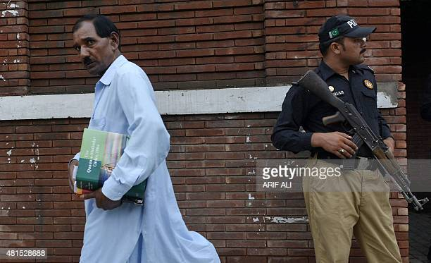 Ashiq Masih husband of Asia Bibi a Christian woman facing death sentence for blasphemy carries law books as he comes out from The Supreme Court in...