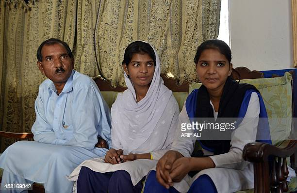 Ashiq Masih the husband of Asia Bibi a Pakistani Christian mother sentenced to death in under blasphemy laws sits with daughters Esham and Esha at...