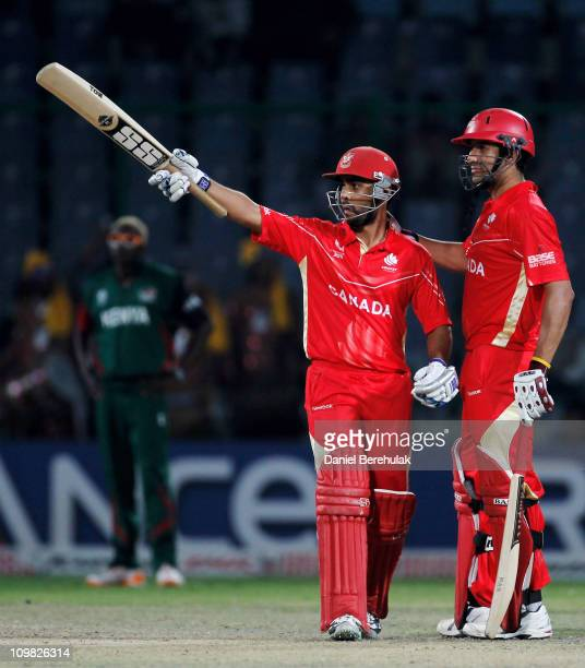 Ashish Bagai of Canada is congratulated by team mate Jimmy Hansra on scoring his half century during the ICC Cricket World Cup group A match between...