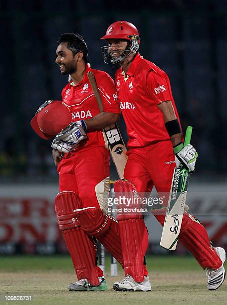 Ashish Bagai of Canada is congratulated by team mate John Davison on scoring the winning runs during the ICC Cricket World Cup group A match between...