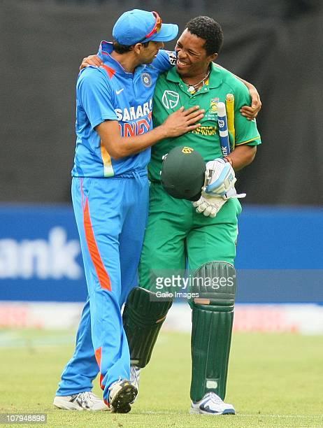 Ashish Nehra and Makhaya Ntini during Standard Bank Pro20 international match between South Africa and India at Moses Mabhida Stadium on January 09...