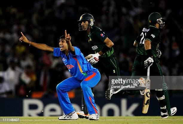 Ashish Nehra of India appeals successfully for the wicket of Umar Gul of Pakistan during the 2011 ICC World Cup second SemiFinal between India and...