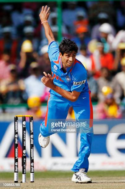Ashish Nehra of India bowls during the 2011 ICC Cricket World Cup Group B match between India and the Netherlands at Feroz Shah Kotla stadium on...