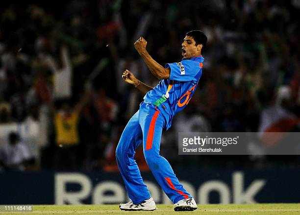 Ashish Nehra of India celebrates after taking the wicket of Umar Gul of Pakistan during the 2011 ICC World Cup second SemiFinal between India and...