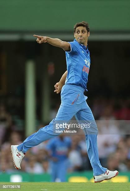 Ashish Nehra of India celebrates taking the wicket of Usman Khawaja of Australia during the International Twenty20 match between Australia and India...