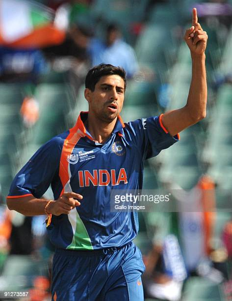 Ashish Nehra of India celebrates the wicket of Devon Smith of the West Indies for 21 runs during The ICC Champions Trophy Group A Match between India...