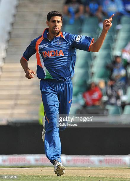 Ashish Nehra of India celebrates the wicket of Kieran Powell of the West Indies for 5 runs during The ICC Champions Trophy Group A Match between...