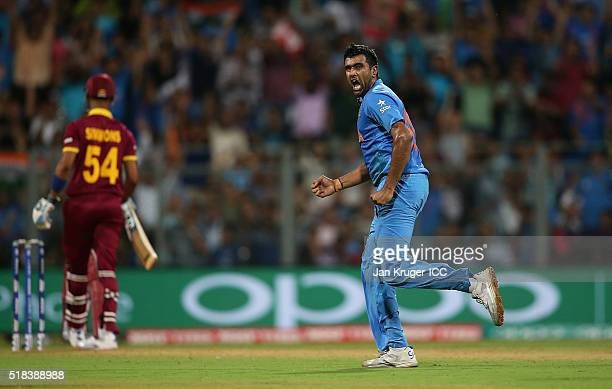 Ashish Nehra of India celebrates the wicket of Marlon Samuels of the West Indies during the ICC World Twenty20 India 2016 SemiFinal match between...