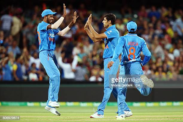 Ashish Nehra of India celebrates with teammates after taking a wicket during game one of the Twenty20 International match between Australia and India...