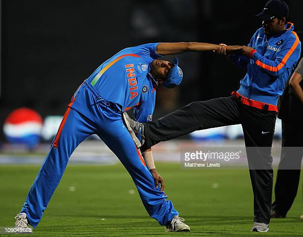 Ashish Nehra of India stretches ahead of the 2011 ICC World Cup Warm up game between India and Australia at the M Chinnaswamy Stadium on February 13...