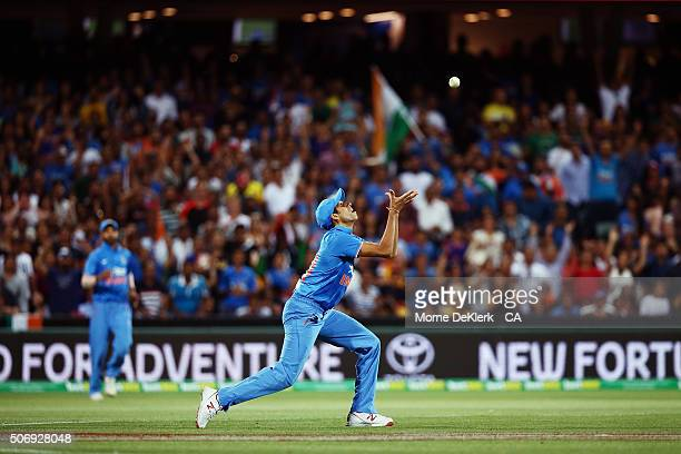 Ashish Nehra of India takes a catch to dismiss Shane Watson of Australia during game one of the Twenty20 International match between Australia and...