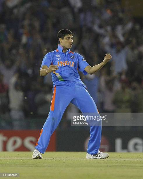 Ashish Nehra reacts after taking a wicket during the ICC cricket world cup semifinal match between India and Pakistan at PCA stadium in Mohali