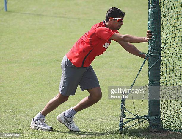 Ashish Nehra warms up during an India nets session at the Punjab Cricket Association Stadium on March 28 2011 in Mohali India