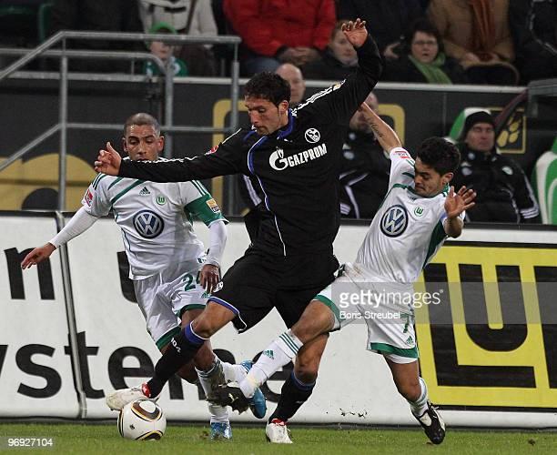 Ashkan Dejagah and Josue of Wolfsburg battles for the ball with Kevin Kuranyi of Schalke during the Bundesliga match between VfL Wolfsburg and FC...