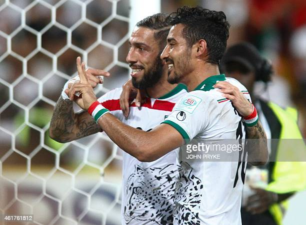 Ashkan Dejagah and Reza Ghoochannejhad of Iran celebrate at the end of the match against the United Arab Emirates after their Group C football match...