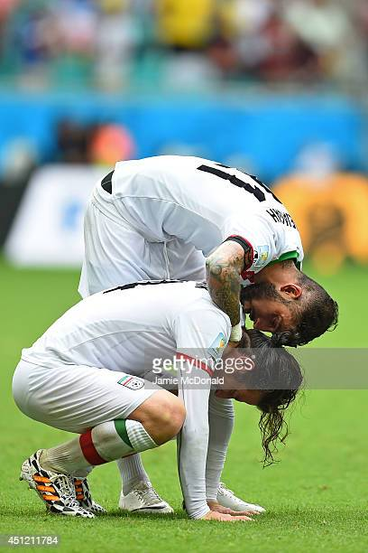 Ashkan Dejagah consoles Andranik Teymourian of Iran after a 31 defeat in the 2014 FIFA World Cup Brazil Group F match between Bosnia and Herzegovina...